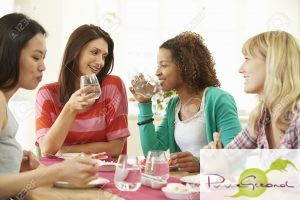 31012574-Group-Of-Women-Sitting-Around-Table-Eating-Dessert-Stock-Photo